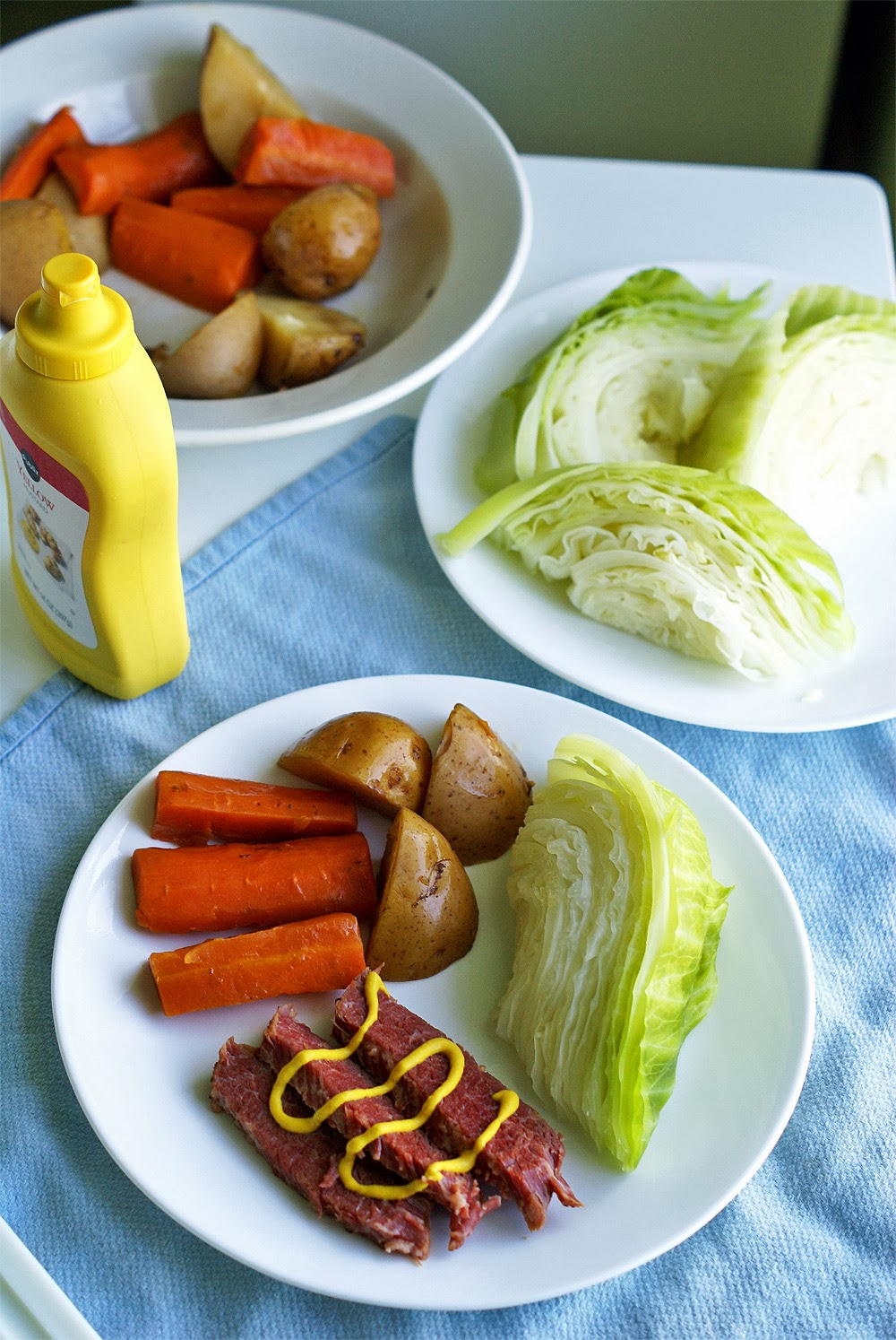 St. Paddy's Day Corned Beef & Cabbage. The juicy, salty meat and tangy yellow mustard go so well with soft, sweet carrots, boiled potatoes and crisp cabbage.