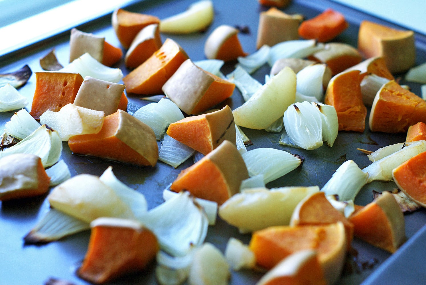 Oven-roasted vegetables make a delicious curried butternut squash and pear soup.